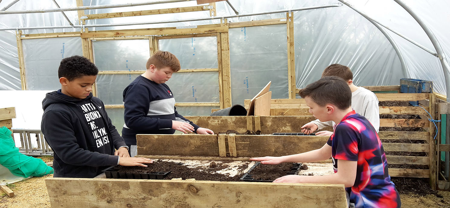 Lakeside Carefarm children planting